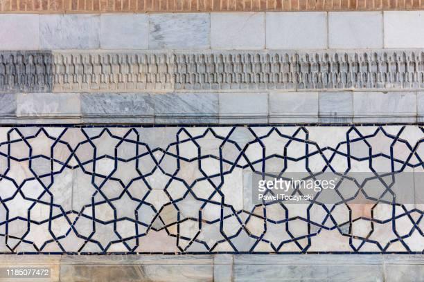 tile patterns of ulugh beg madrasah in registan - the central square of ancient samarkand surrounded by 3 madrassas, uzbekistan, 2019 - アラベスクポジション ストックフォトと画像