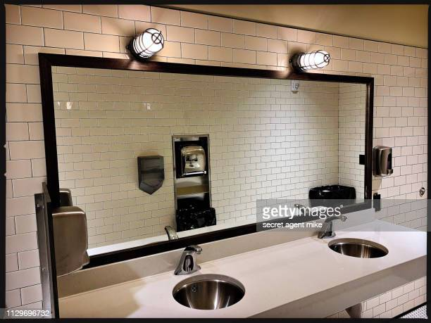 tile public bathroom - vanity mirror stock photos and pictures