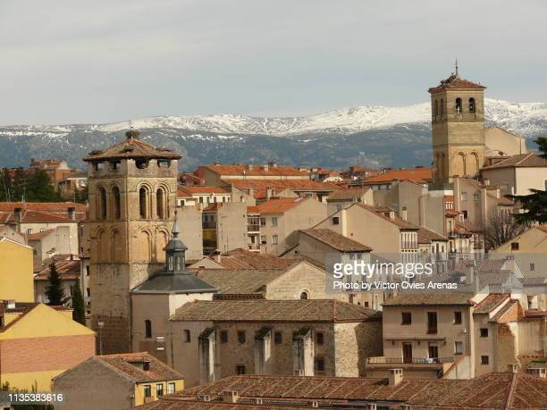 tile roofs and bell towers in the old city of segovia, spain - victor ovies fotografías e imágenes de stock