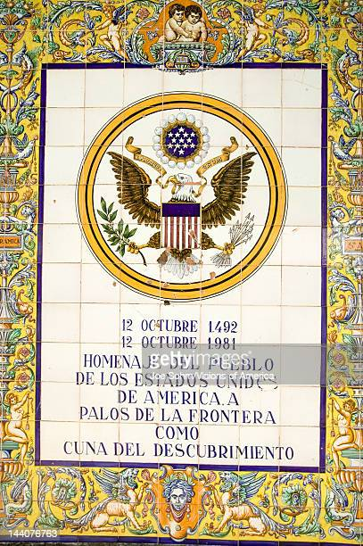 Tile sign along the Avenida de America reads 'Homage of the people of the United States of America to Palos de la Frontera cradle of the discovery'...