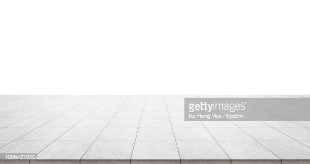 tiled floor against clear sky - tiled floor stock pictures, royalty-free photos & images