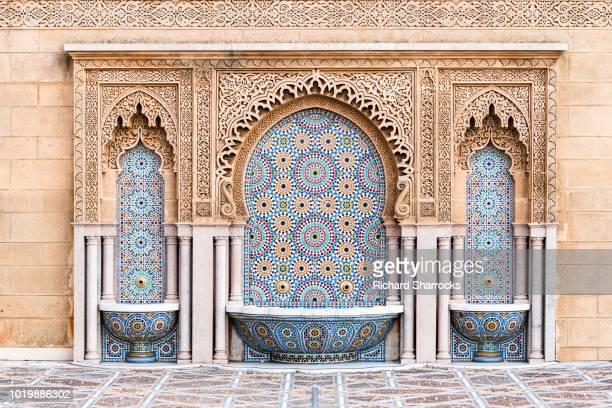 tiled fountain on mosque hassan in rabat, morocco - mosque hassan ii stock photos and pictures