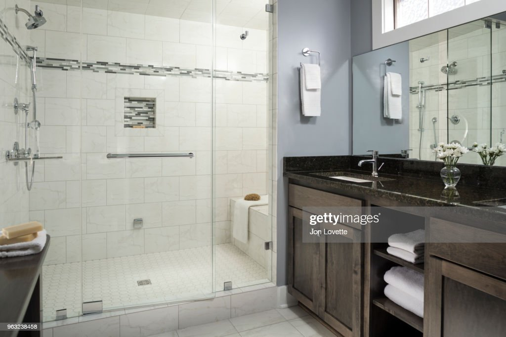 Tiled Modern Bathroom With Glass Shower Doors And Steam Shower Stock ...
