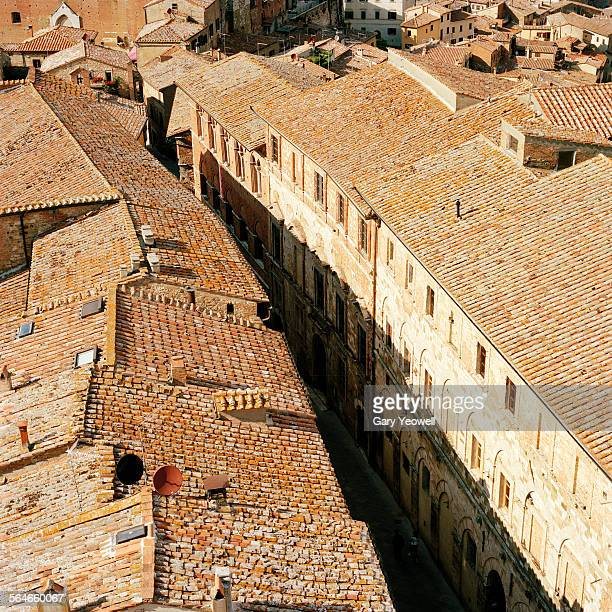 tiled rooftops of hill town of montepulciano - yeowell stock photos and pictures