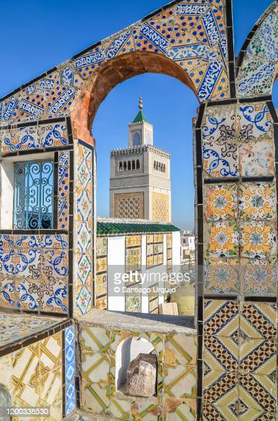 tiled wall and mosque minaret - tunisia stock pictures, royalty-free photos & images