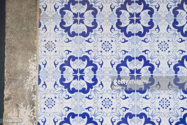tiled wall with floral pattern. lisbon, portugal. - portuguese culture stock pictures, royalty-free photos & images