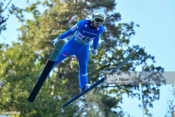 Tilen Bartol of Slovenia competes during the FIS Grand Prix Skijumping Hinzenbach at on February 6, 2021 in Eferding, Austria.