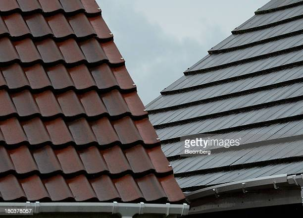 Tiles and platic guttering sit on the roofs of residential property in NewcastleuponTyne UK on Wednesday Sept 11 2013 UK house prices rose for a...