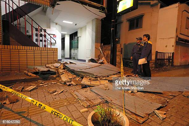 Tiles are scattered from the wall of an aparment building after the magnitude 66 earthquake hit the area on October 21 2016 in Kurayoshi Tottori...
