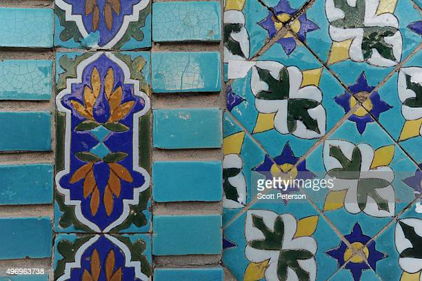 Tiles of the ancient Blue Mosque shine as Afghans go about daily life despite security fears of a resurgent Taliban across the country on November 10...