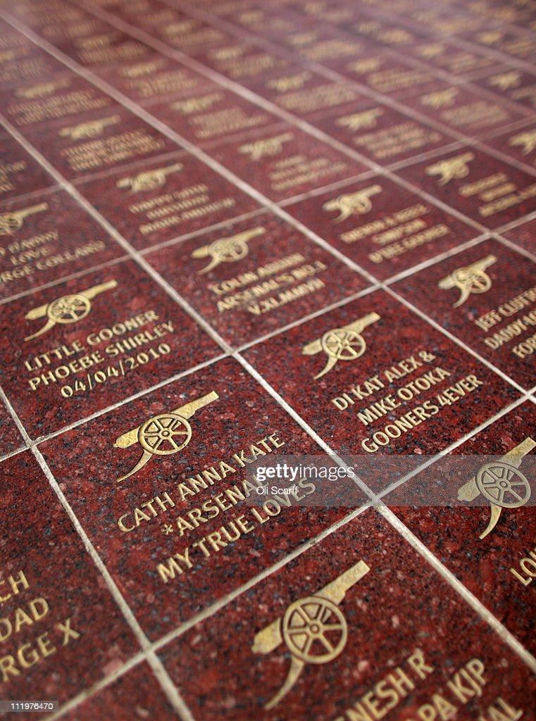 Tiles with personalised messages are displayed outside Arsenal Football Club's Emirates Stadium on April 11, 2011 in London, England. American businessman Stan Kroenke's company 'Kroenke Sports Enterprises' has increased its shareholding in Arsenal to 62.89% and will make an offer for a full takeover of the club. Kronke first purchased 9.9% of Arsenal shares in 2007. Today's deal values the Premier League club at 731m GBP.