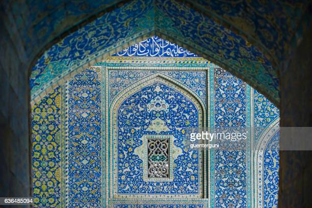 tilework at shah mosque on imam square, isfahan, iran - calligraphy stock photos and pictures