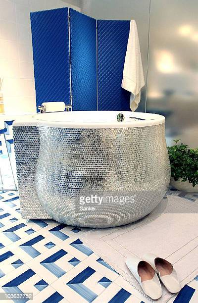 Tiling building materials and sanitary fixtures manufacturer INAX reveals a luxury bathtub which use white gold tiles at their showroom on August 24...