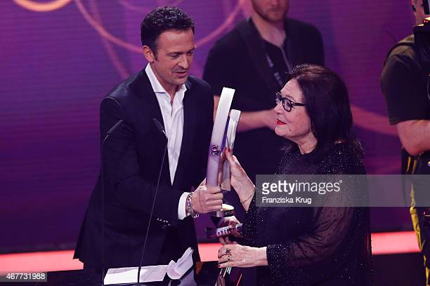 Till Broenner and Nana Mouskouri attend the Echo Award 2015 show on March 26 2015 in Berlin Germany
