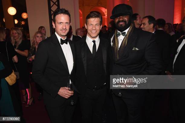 Till Broenner Frank Briegmann and Gregory Porter attend the GQ Men of the year Award 2017 after show party at Komische Oper on November 9 2017 in...