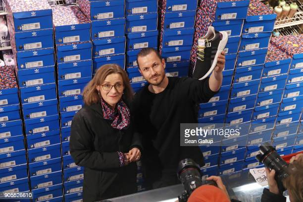 Till Jagla Global Senior Director of adidas Originals Footwear Concepts and Sigrid Nikutta director of the Berlin BVG public transport authority pose...