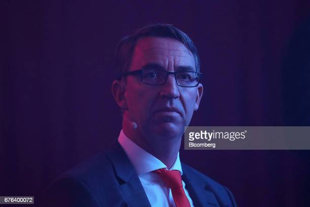 Till Reuter chief executive officer of Kuka AG listens during the B20 Summit a business forum linked to Germany's G20 presidency in Berlin Germany on...