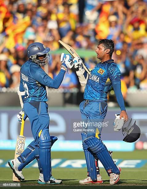 Tillakaratne Dilshan congratulates Kumar Sangakkara of Sri Lanka for reaching his century during the 2015 ICC Cricket World Cup match between Sri...