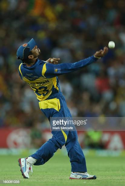 Tillakaratne Dilshan of of Sri Lanka celebrates taking a catch to dismiss George Bailey of Australia during game one of the Twenty20 international...