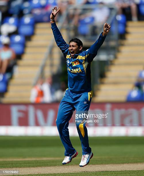 Tillakaratne Dilshan of Sri Lanka appeals successfully for the wicket of James Franklin of New Zealand during the ICC Champions Trophy group A match...