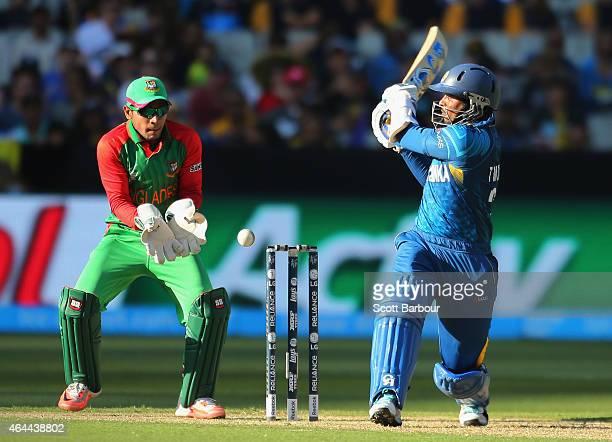 Tillakaratne Dilshan of Sri Lanka bats as wicketkeeper Mushfiqur Rahim of Bangladesh looks on during the 2015 ICC Cricket World Cup match between Sri...