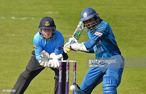 Tillakaratne Dilshan of Sri Lanka batting and Ben Brown wicketkeeper of Sussex during the T20 match between The Sussex Sharks and Sri Lanka played at...