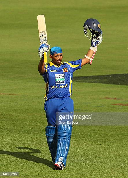 Tillakaratne Dilshan of Sri Lanka celebrates after reaching his century during the One Day International match between India and Sri Lanka at...