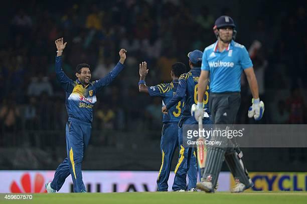 Tillakaratne Dilshan of Sri Lanka celebrates dismissing England captain Alastair Cook during the 1st One Day International between Sri Lanka and...