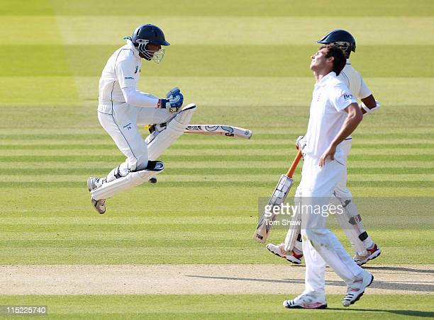 Tillakaratne Dilshan of Sri Lanka celebrates his century as Steven Finn of England looks dejected during day two of the 2nd npower Test Match between...