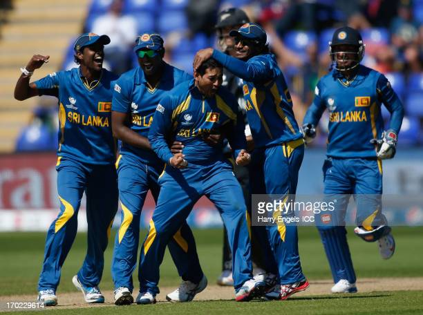 Tillakaratne Dilshan of Sri Lanka celebrates with teammates after dismissing James Franklin of New Zealand during the ICC Champions Trophy group A...