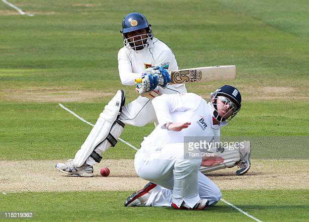 Tillakaratne Dilshan of Sri Lanka hits out as Ian Bell of England takes evasive action during day two of the 2nd npower Test Match between England...