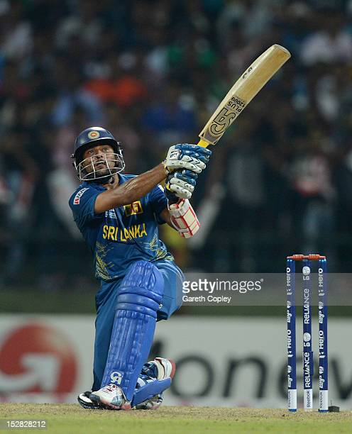 Tillakaratne Dilshan of Sri Lanka hits out for six runs during the ICC World Twenty20 2012 Super Eights Group 1 match between Sri Lanka and New...