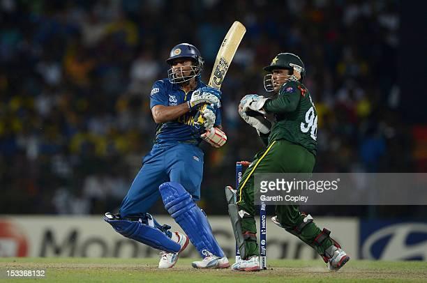 Tillakaratne Dilshan of Sri Lanka hits past Pakistan wicketkeeper Kamran Akmal during the ICC World Twenty20 2012 Semi Final between Sri Lanka and...