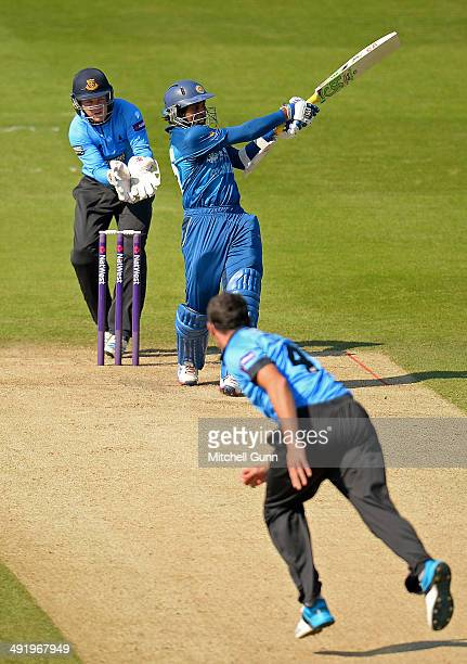 Tillakaratne Dilshan of Sri Lanka hits the ball for a boundary off the bowling of Jon Lewis of Sussex during the T20 match between The Sussex Sharks...