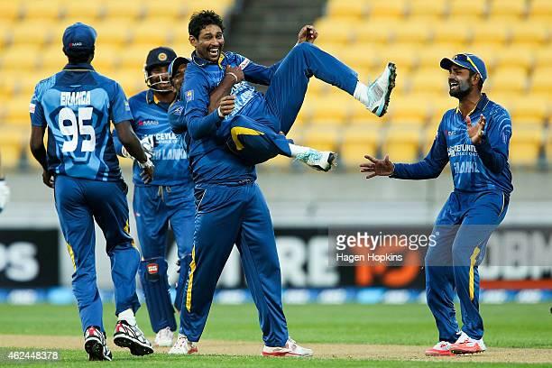 Tillakaratne Dilshan of Sri Lanka is congratulated by teammates Shaminda Eranga Seekkuge Prasanna and Lahiru Thirimanne after taking the wicket of...