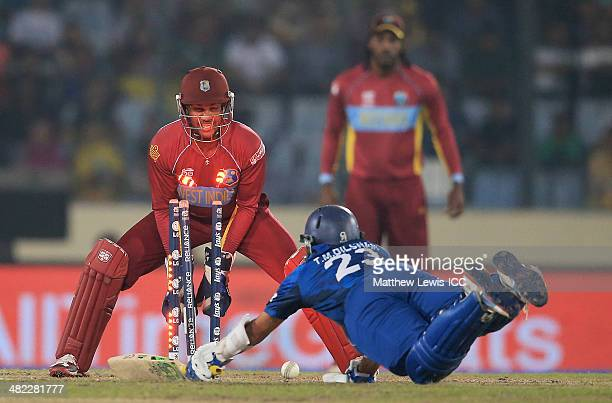 Tillakaratne Dilshan of Sri Lanka is run out by Lendl Simmons of the West Indies as Denesh Ramdin looks on during the ICC World Twenty20 Bangladesh...