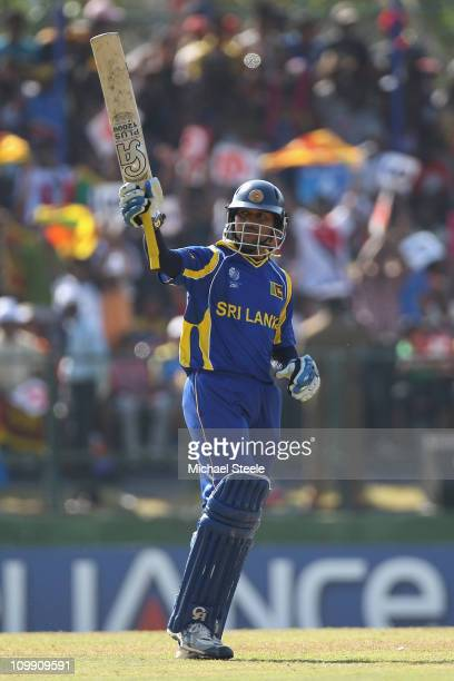 Tillakaratne Dilshan of Sri Lanka raises his bat to the crowd after reaching his fifty during the Sri Lanka v Zimbabwe 2011 ICC World Cup Group A...