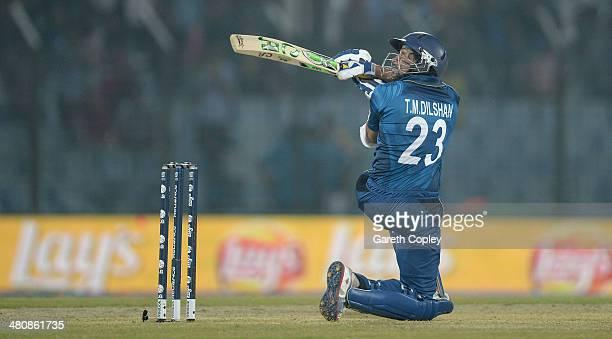 Tillakaratne Dilshan of Sri Lanka scoops the ball for six runs during the ICC World Twenty20 Bangladesh 2014 Group 1 match between England and Sri...