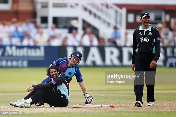 Tillakaratne Dilshan of Surrey and Eoin Morgan of Middlesex pick themselves up after colliding as Vikram Solanki of Surrey laughs during the Royal...