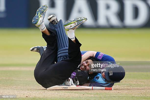 Tillakaratne Dilshan of Surrey laughs after he collided with Eoin Morgan of Middlesex during the Royal London OneDay Cup match between Middlesex...