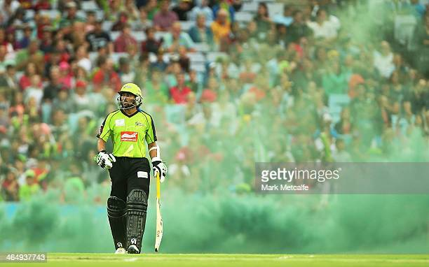 Tillakaratne Dilshan of the Thunder walks onto the field at the start of the Big Bash League match between Sydney Thunder and the Sydney Sixers at...