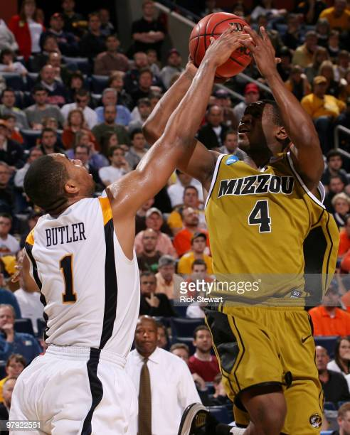 Tiller of the Missouri Tigers gets blocked by Da'Sean Butler of the West Virginia Mountaineers during the second round of the 2010 NCAA men's...
