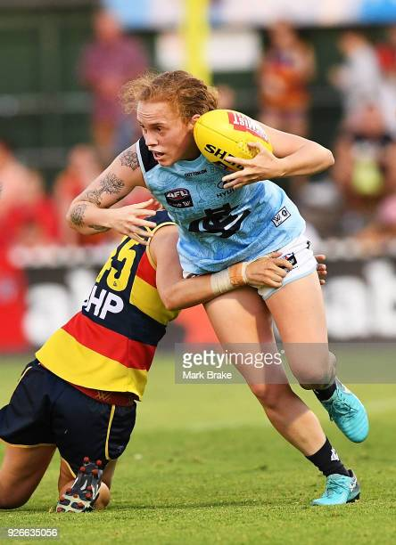 Tilly LucasRodd of Carlton breaks a tackle from Rheanne Lugg of the Adelaide Crows during the round five AFLW match between the Adelaide Crows and...