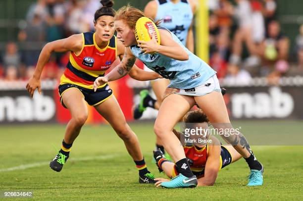 Tilly LucasRodd of Carlton gets away from two opponents during the round five AFLW match between the Adelaide Crows and the Carlton Blues at Norwood...
