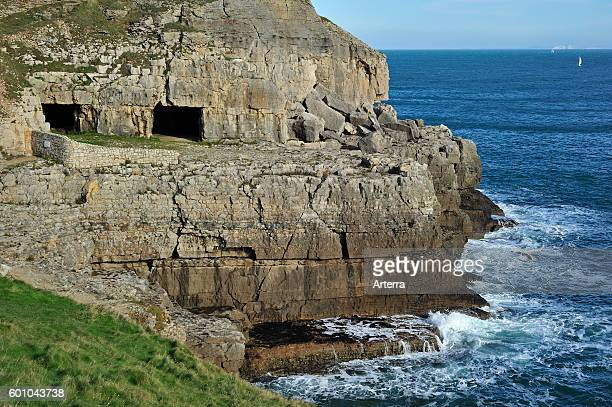 Tilly Whim quarry and caves at Anvil Point, Durlston Head on the Isle of Purbeck along the Jurassic Coast in Dorset, southern England, UK.