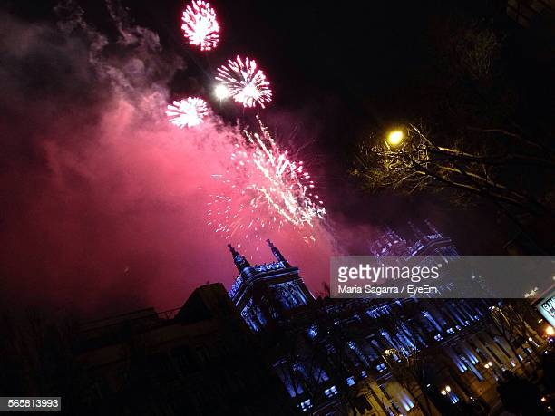 Tilt Image Of Firework Display Of Historic Building At Night