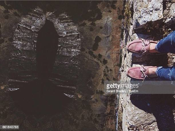 Tilt Image Of Person Standing At Edge Of Rock