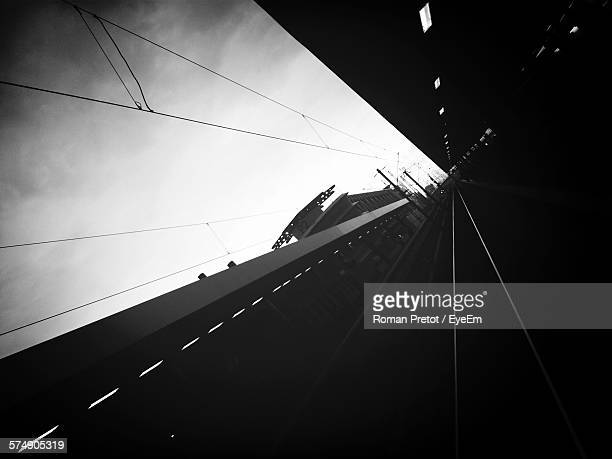 tilt image of railroad station against sky - roman pretot stock-fotos und bilder