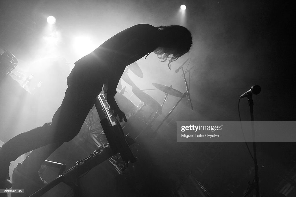 Tilt Image Of Silhouette Pianist Performing During Music Festival : Stock Photo
