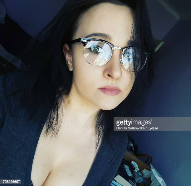 tilt portrait of beautiful woman wearing eyeglasses at home - cleavage stock pictures, royalty-free photos & images